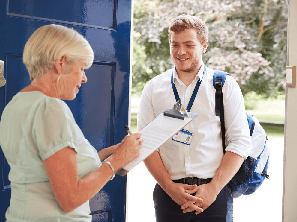 Woman verifies credentials of young man at door